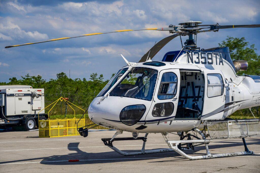 An AS350 B3 sits on the helipad