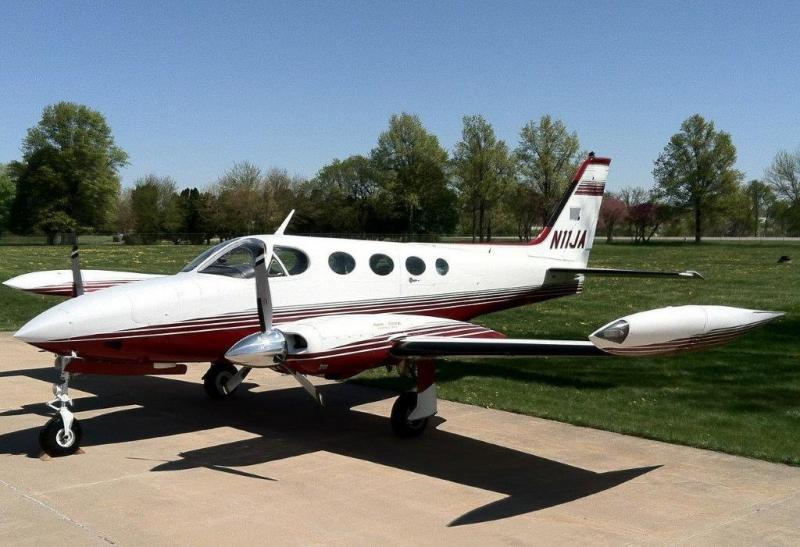 A Cessna 340 airplane sits on the tarmac
